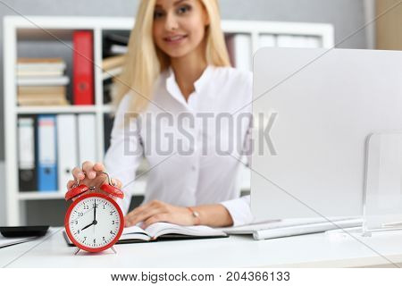 Smiling Business Woman Holding Hand On The Alarm Clock