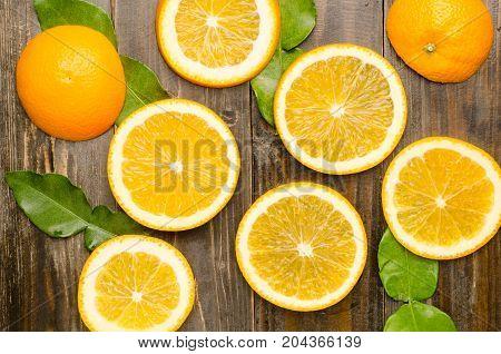 Slice Navel orange fruit on wooden background,citrus fruit pattern background
