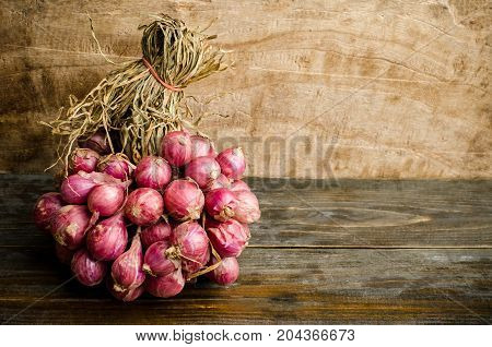 Fresh shallots on wooden background,spices and herbs,food ingredients