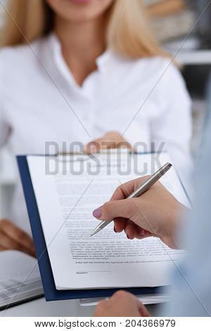 Female Arm In White Shirt Offer Contract Form On Clipboard Pad