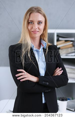 Blonde Business Woman Portrait On A Office Background