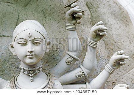 Clay idol of Goddess Durga under preparation for