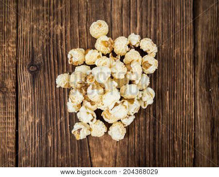 Portion Of Popcorn On Wooden Background, Selective Focus