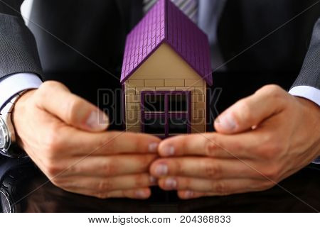 Man In Suit And Tie Cover With Arms Little Toy House
