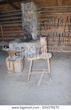 Vintage calvary military blacksmith shop displayed indoors.