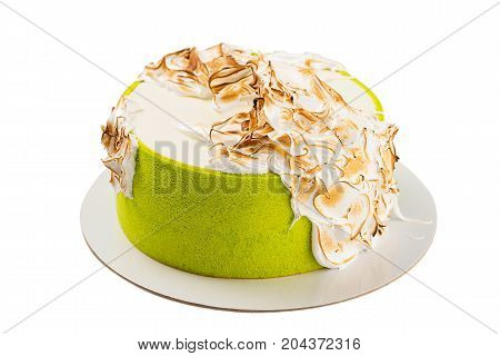 Green Cake Decorated With Burned Meringue Isolated On White