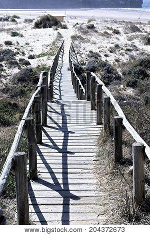 Wooden Footbridge across the Sand Dunes on the Atlantic coast of Portugal Stylized Photo