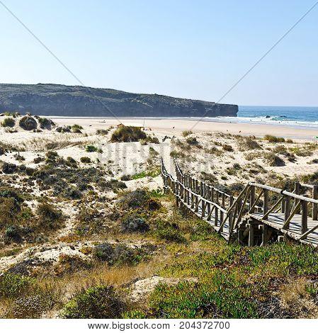 Wooden Footbridge across the Sand Dunes on the Atlantic coast of Portugal