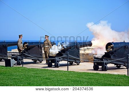 VALLETTA, MALTA - MARCH 31, 2017 - Army personnel firing the Noon Gun in Upper Barrakka Gardens Valletta Malta Europe, March 31, 2017.
