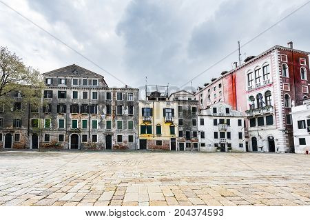 Houses peeling off from dampness. Venice is situated across a group of islands that are separated by canals and linked by bridges.