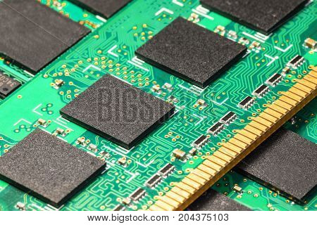 Macro view of the group of computer PC DRAM memory modules circuit board PCB with selective focus effect