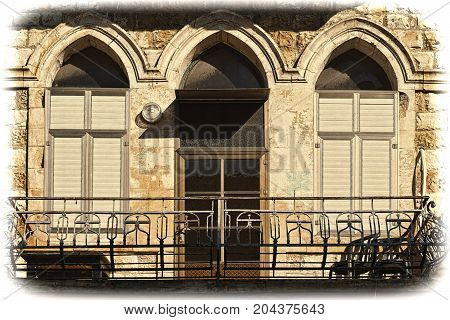 Windows of traditional stoned house in old Acre. Arab architecture of the old city of Akko in Israel. Vintage style toned picture