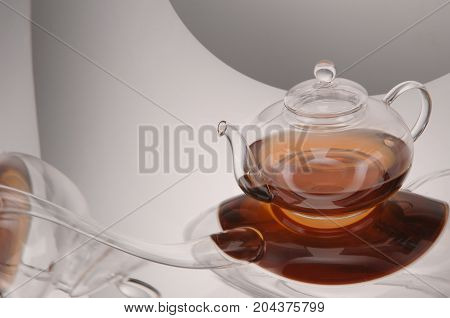 Transparent Glass Teapot And Cup With Tea