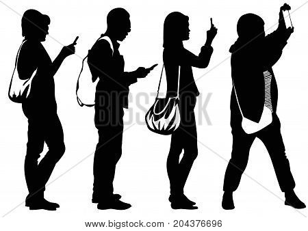 Silhouettes of people busy with cell phones - vector