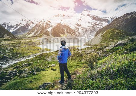 Mountain Hiker Traveling In Wilderness Landscape.