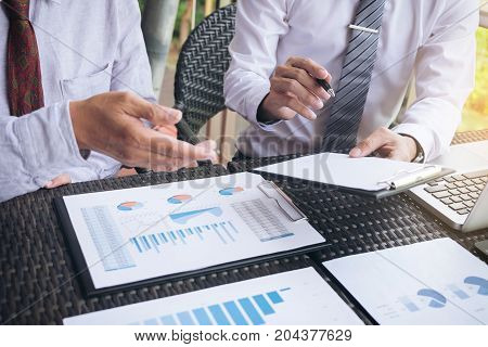 Business team meeting present investor executive colleagues discussing new plan financial graph data on outdoors office table with laptop and tablet Finance accounting investment.