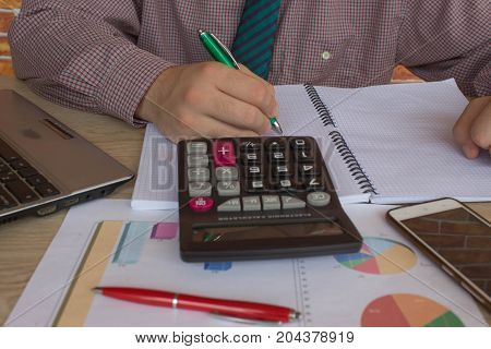 view of bookkeeper or financial inspector hands making report calculating or checking balance. Home finances investment economy saving money or insurance concept