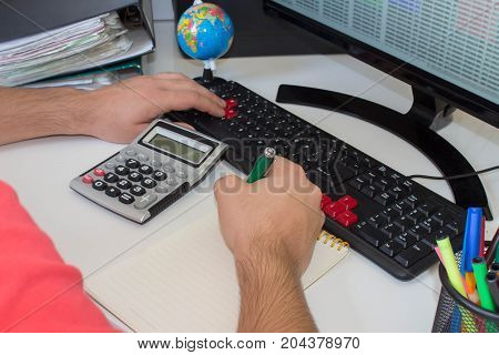 The calculators business owners accounting and technology business computer laptop calculator and documents in the office. Business male Analyzing Statistics Financial business Concept