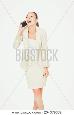 Young happy caucasian woman is calling with a mobile phone.