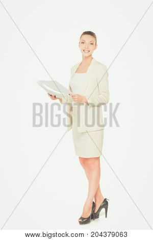 Portrait of a confident young woman standing with folder isolated on white background.