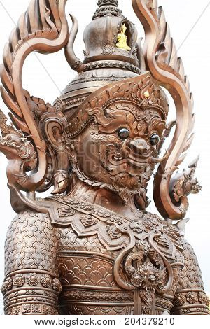 Colorful Thai style titan giant statue isolated on white backgrounds, One of character Monster guardian in Thai culture fiction with scary appearance face eye and teeth