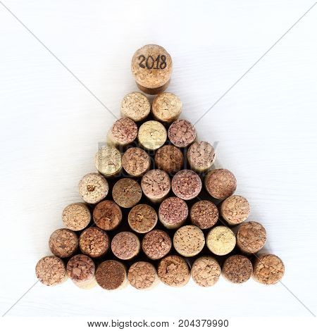 festive Christmas tree made of wine stoppers with a top decorated with a cork with a number/ idea New Year tree 2018