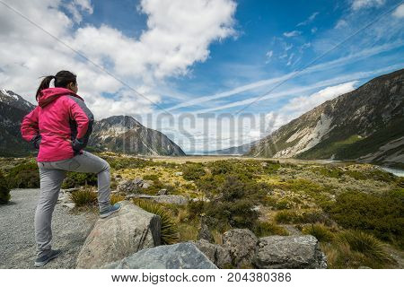 Woman Traveller Traveling In Wilderness Landscape