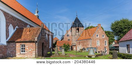 GREETSIEL, GERMANY - JULY 18, 2017: Panorama of the historic church in Greetsiel, Germany