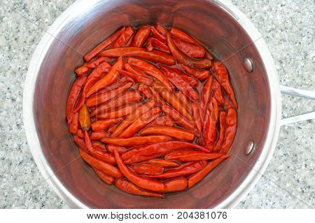 Flat Lay View Of Hot Red Chillies Cooked In A Metal Pot