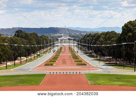 Canberra is Australia's capital city and was selected to be purpose built as the capital city in 1908. This view is from the Australian War Memorial along Anzac Parade towards the old and new Houses of Parliament.