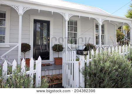Traditional houses front in suburb in Auckland New Zealand. Traditional villa in Ponsonby Auckland New Zealand.Buy sale real estate insurance mortgage bank loans and housing market concept.