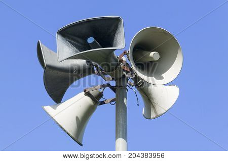 Public address system consisting of five megaphones
