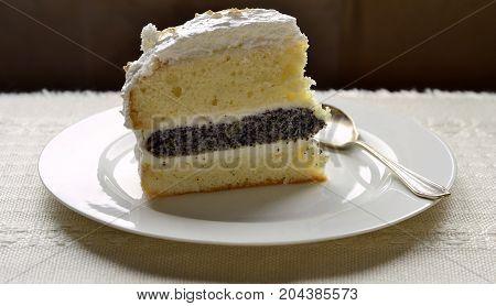 Lemon poppy seed sponge cake with curd cream and meringue