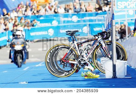 STOCKHOLM - AUG 26 2017: Parked cycles and motorcycle in the background in the transition zone in the Women's ITU World Triathlon series event August 26 2017 in Stockholm Sweden