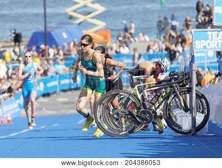 STOCKHOLM - AUG 26 2017: Female triathlete Ashleigh Gentle (AUS) and Andrea Hewitt (NZL) running in the transition zone in the Women's ITU World Triathlon series event August 26 2017 in Stockholm Sweden