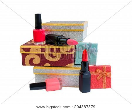 Gift boxes lipsticks and nail polishes isolated on white background