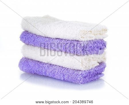 colored towels on a white background .