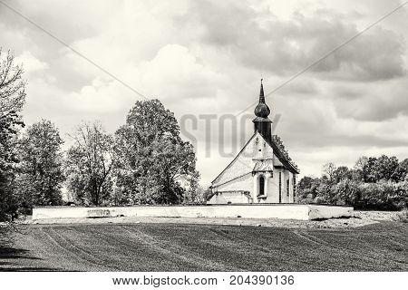 Chapel of Our Mother God near Veveri castle Moravia Czech republic. Religious architecture. Travel destination. Black and white photo.