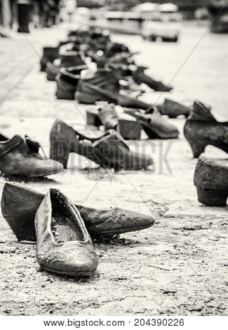 Shoes monument on the Danube bank is a memorial in Budapest Hungary. Place of reverence. Symbolic object. Black and white photo.