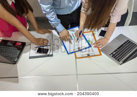 Aerial view of business people discuss about the sales report