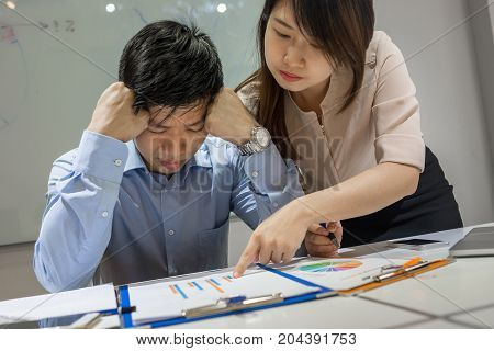 Asian businessman feels tired and exhausted because of many problems