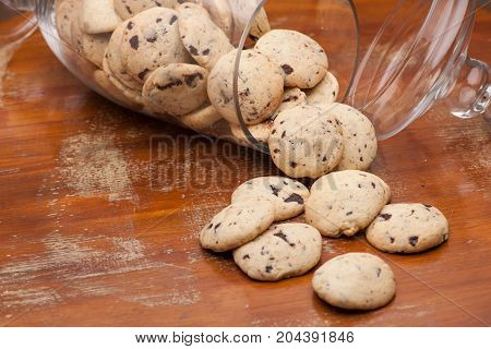 cookies in a glass vase scattered on the table