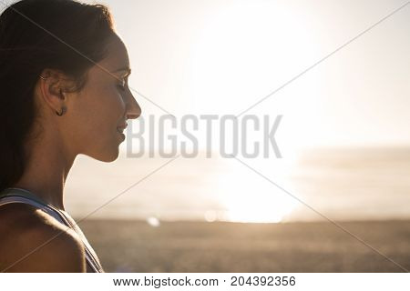 Woman Enjoying Beautiful Sunset On The Beach