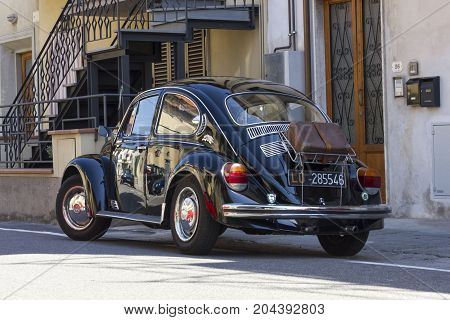 LASTRA A SIGNA, ITALY - AUGUST 30 3015: Black vintage Beetle parked on the street in Lastra a Signa Tuscany