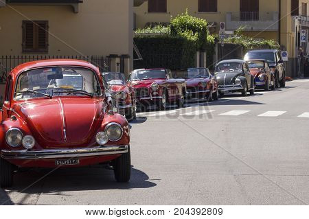 LASTRA A SIGNA, ITALY - AUGUST 30 2015: Row of vintage cars parked on the street in Lastra a Signa during an historic cars exhibition
