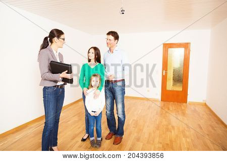 realtor showing a family of three an apartment, discussing contract details
