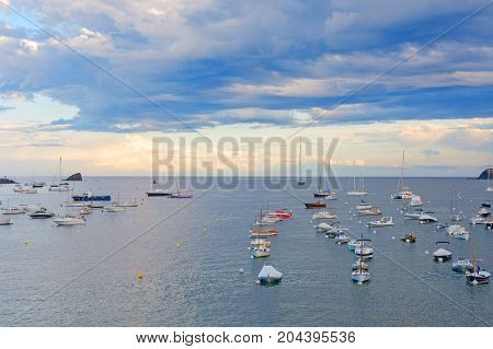 Bay and boats in the port of Cadaques Costa Brava province Girona Catalonia Spain. This fishing village lived facing the sea and separated by land until the end of the 19th century.