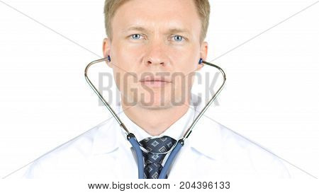 Portrait Of Doctor Wearing Stethoscope Isolated On White Background