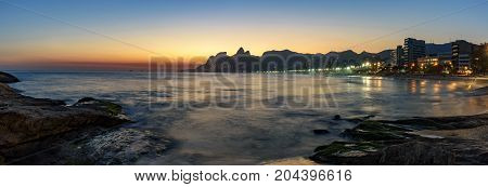 Night arriving at the Arpoador stone Ipanema beach in Rio de Janeiro