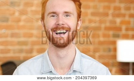 Laughing On Joke, Young Man Portrait In Office At Work